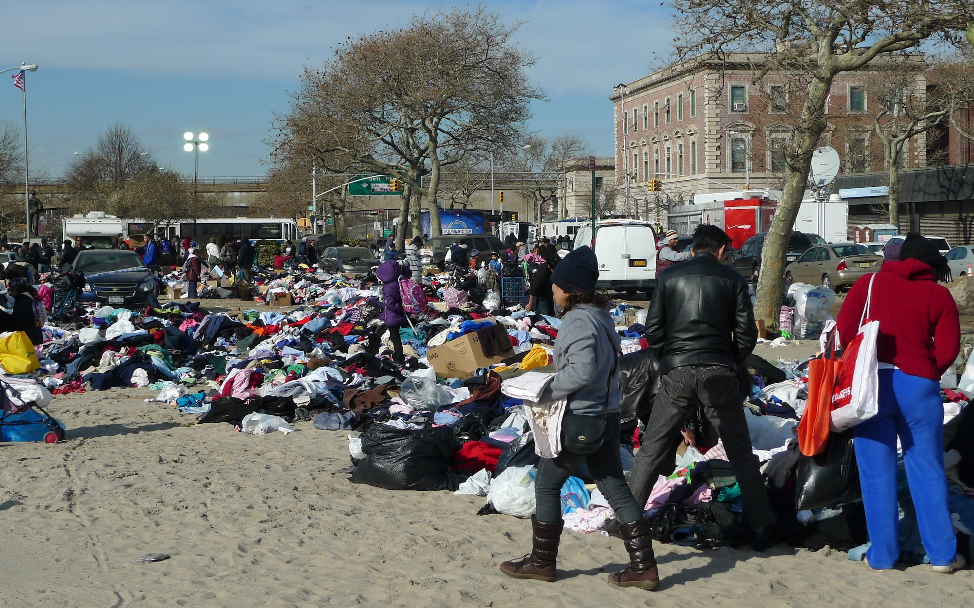 Gathering clothes on the sand covered parking lot
