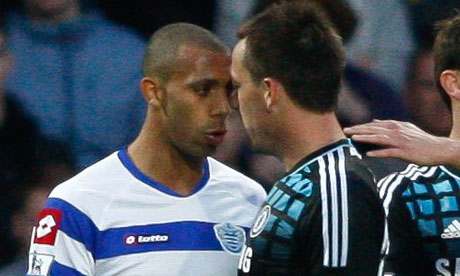 British footballers Anton Ferdinand and John Terry confront each other over hate speech from Terry